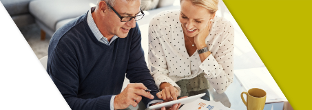 A couple reviewing Lead Bank Money Market rates online