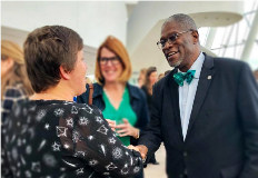 Mayor Sly James shaking hands with Lead Bank Employee