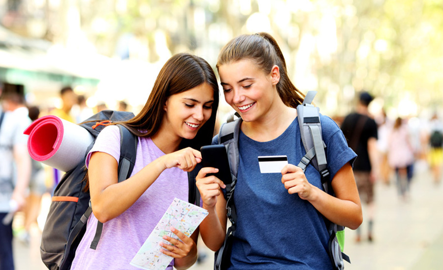 Two teen students using a checking account to help them learn how to keep track of money
