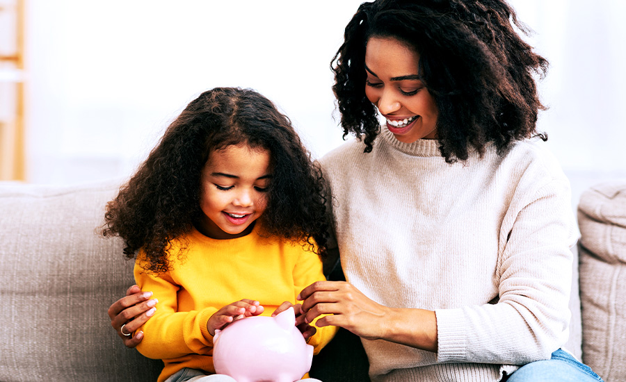 A mother and daughter exploring financial wellness and saving money