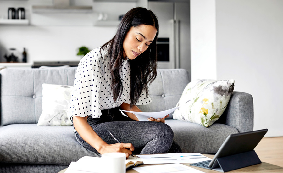 A woman developing a household budget in her living room