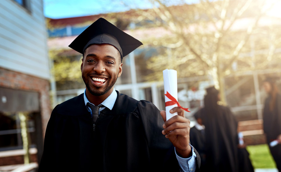 A male African American student who has recently graduated college and is ready to start paying back student loans