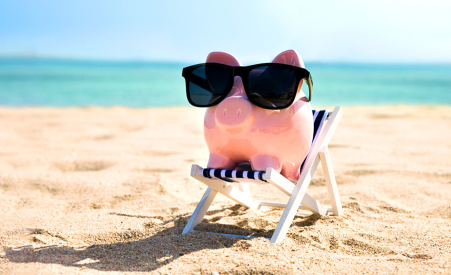An image of a piggy bank on the beach after considering 401(k) and IRA plans to save for retirement