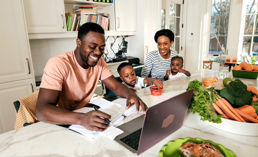 A happy family reviewing finances to determine their family's top financial needs