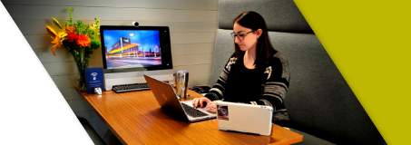 A Lead Bank Banker working at her careers in the Kansas City community location
